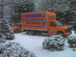 Water Damage Restoration Truck At Winter Job Location